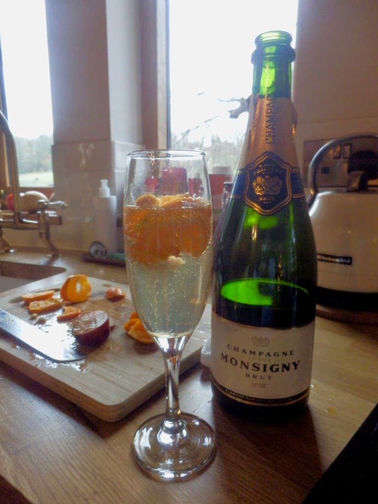 Champagne and Fresh Oranges