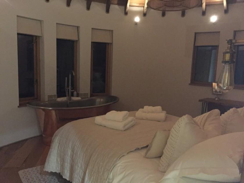 Master Bedroom with Freestanding Copper Bath